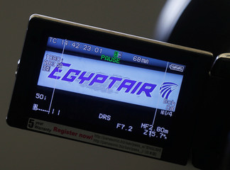 The company logo is displayed on a video camera screen at the Egyptair desk at Charles de Gaulle airport in Paris