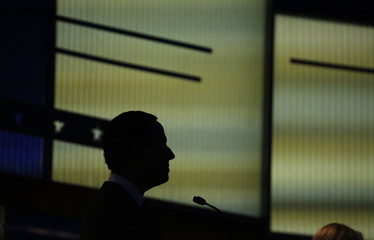 Republican U.S. presidential candidate and former U.S. Senator Rick Santorum is silhouetted against the debate backdrop during a forum for the lower polling candidates in Des Moines
