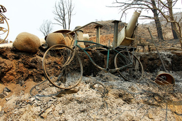 A bicycle sits among the debris at a destroyed home after the Soberanes Fire burned through the Palo Colorado area, north of Big Sur, California
