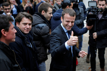 Emmanuel Macron, head of the political movement En Marche !, or Forward! and former French Economy Minister, arrives to attend a news conference in Paris