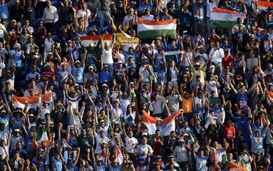 Fans cheer as India wins their ICC Champions Trophy group B match against South Africa at Cardiff Wales Stadium in Cardiff
