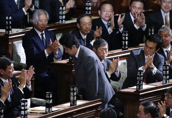 The leader of Liberal Democratic Party (LDP) Abe bows as he is applauded by his party members after being elected as Japan's prime minister at the Lower House of the Parliament in Tokyo