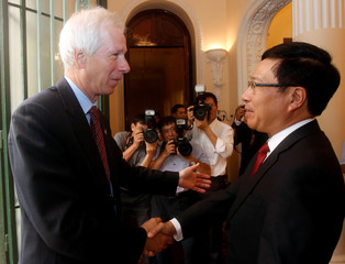 Canada's Foreign Minister Stephane Dion is greeted by Vietnam's Deputy Prime Minister and Foreign Minister Pham Binh Minh at the Government Guesthouse in Hanoi