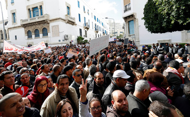 Teachers and professors gather in front of the Ministry of Education to protest against the budget for 2017, in Tunis