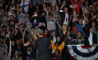 Supporters cheer U.S. President Barack Obama after he gave his victory speech during his election night rally in Chicago