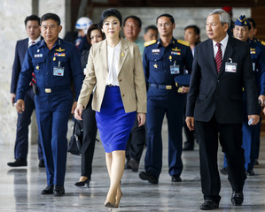 Thailand's Prime Minister Yingluck Shinawatra leaves the Royal Thai Air Force headquarters after a cabinet meeting in Bangkok
