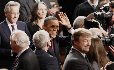 U.S. President Barack Obama waves as he arrives to deliver the State of the Union address to a joint session of Congress on Capitol Hill in Washington