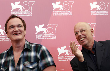 U.S. director and producer Tarantino and Italian director Salvatores pose during a photocall in Venice