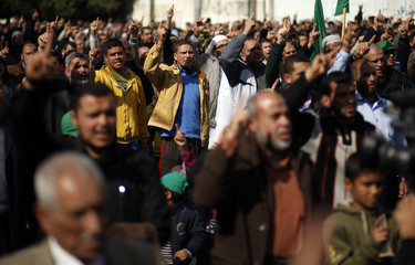 Palestinians chant slogans after performing Friday prayers during a protest against the decision of an Egyptian court to list Hamas' armed wing as a terrorist organization, outside the Egyptain embassy in Gaza City