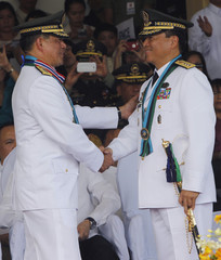 Outgoing AFP Chief of Staff General Dellosa welcomes newly installed Chief of Staff Lieutenant General Bautista during an AFP change of command ceremony at Camp Aguinaldo military headquarters in Quezon, Manila
