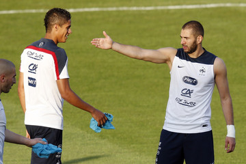 France's national soccer team players Benzema and Varane, both of Real Madrid, attend a training session at Botafogo soccer club's Santa Cruz stadium in Ribeirao Preto
