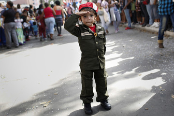 A child dressed as Venezuelan President Hugo Chavez parade during the Carnival festival in Caracas