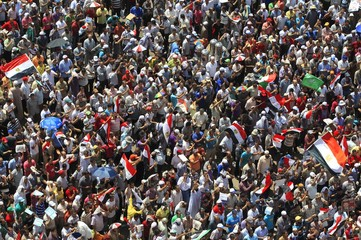 Supporters of Muslim Brotherhood's presidential candidate Mohamed Morsy chant slogans during a rally at Tahrir Square in Cairo