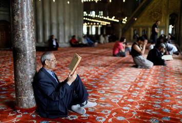 Man reads the Koran on the first day of the fasting month of Ramadan in Istanbul