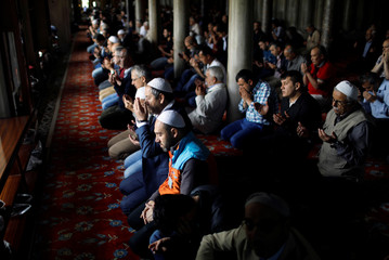 People pray on the first day of the fasting month of Ramadan in Istanbul