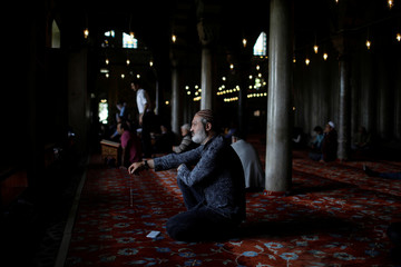 Man listens to the Koran on the first day of the fasting month of Ramadan in Istanbul