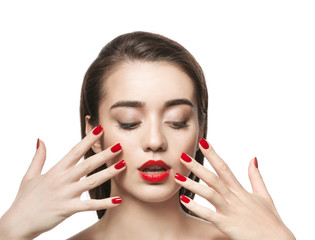 Portrait of beautiful woman with red lips on white background