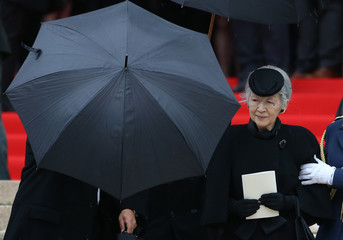 Japan's Empress Michiko leaves Saint-Gudule cathedral in Brussels after a funeral service for Belgium's Queen Fabiola