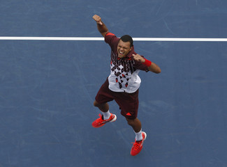 Jo-Wilfried Tsonga of France celebrates his win over Sergei Bubka of Ukraine in their match at the U.S. Open tennis tournament in New York