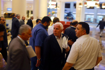 Fatah official and delegation leader Azzam Ahmed and other Palestinian negotiators arrive at a hotel after negotiations in Cairo