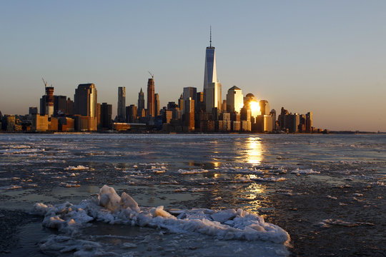 Ice floes are seen along the Hudson River with the One World Trade Center tower in the background, in New York