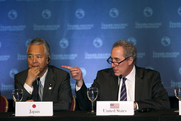 Japanese Economy Minister Akira Amari and US Trade Rep. Michael Fromam participate in a press conference in Lahaina, Maui, Hawaii