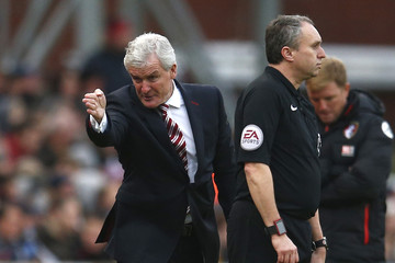 Stoke City manager Mark Hughes gestures as Bournemouth manager Eddie Howe looks on
