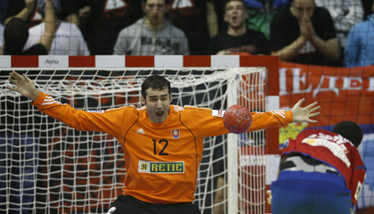 Slovakia's goalkeeper Stochl makes a save against Serbia's Marko Vujin during their Men's European Handball Championship Group A match in Belgrade