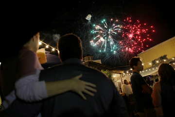 People watch the annual fireworks display during a visit by U.S. President Barack Obama and his family in Oak Bluffs