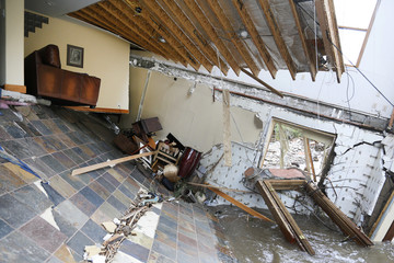 A destroyed house with furniture still intact inside is seen in Jamestown, Colorado