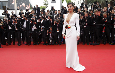 Pop singer Cheryl Cole arrives on the red carpet for the screening of the film Habemus Papam in competition at the 64th Cannes Film Festival