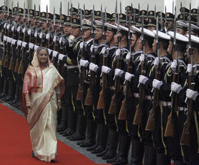 Bangladesh Prime Minister Hasina walks past Chinese honour guard during her official welcoming ceremony in the Great Hall of the People in Beijing