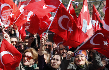Supporters of Turkey's main opposition The Republican People's Party shout slogans and wave Turkey's national flags during a demonstration in Ankara