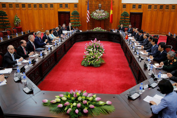 U.S. President Barack Obama and the U.S. delegation attends a bilateral meeting with Vietnam's PM Nguyen Xuan Phuc at the Presidential Palace Compound in Hanoi