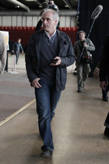 Poutou, Anti-Capitalist Party (NPA) candidate for the 2012 French presidential election, arrives to attend a news conference before a campaign rally in Paris