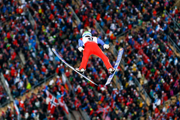 Fannemel of Norway soars through the air during the men's large hill individual ski jumping event at the Nordic World Ski Championships in Falun