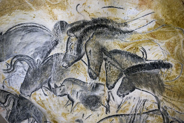 A replica of pre-historic drawings showing horses, rhinoceros and aurochs is seen on a wall at the site of the Cavern of Pont-d'Arc project in Vallon Pont d'Arc