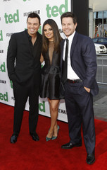 "MacFarlane poses with co-stars Wahlberg and Kunis at the premiere of ""Ted"" in Hollywood"