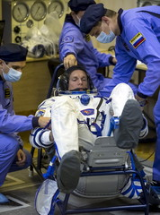 Astronaut Andreas Mogensen of Denmark is assisted during a space suit check at the Baikonur cosmodrome
