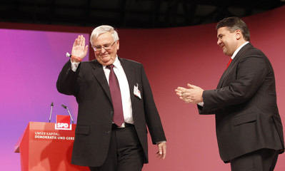 Germany's SPD party leader Gabriel applauds to DFB President Zwanziger in Berlin