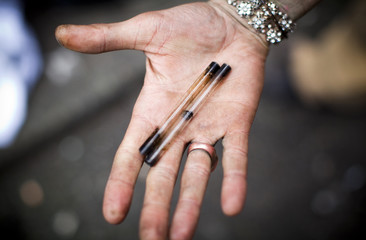 A man holds his used crack pipes in Vancouver's DTES neighbourhood, British Columbia