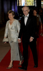 European Council PR Herman Van Rompuy and his wife Geertrui Windels arrive at a gala dinner organised on the eve of the abdication of Queen Beatrix of the Netherlands in Amsterdam