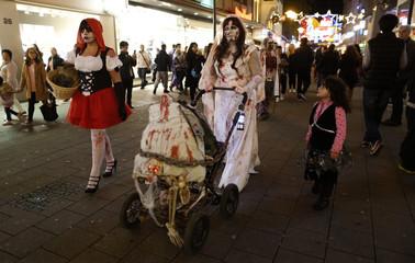 Revellers take part in a Zombie Walk in Essen