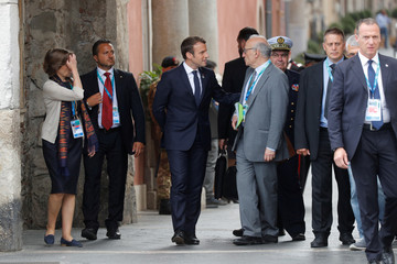 French President Emmanuel Macron arrives for a press conference at the end of the G7 Summit in Taormina