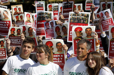 Camila Speziale's parents and her siblings join Greenpeace activists during a demonstration against the detention of Greenpeace activists in Russia, in Buenos Aires