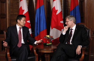 Mongolia's PM Sukhbaatar Batbold speaks with Canada's PM Stephen Harper on Parliament Hill in Ottawa