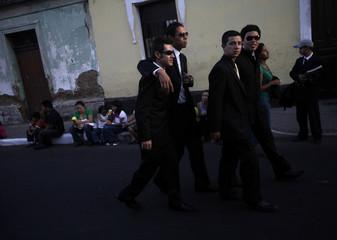 Catholic faithfuls arrive for a Holy Week procession in Guatemala City