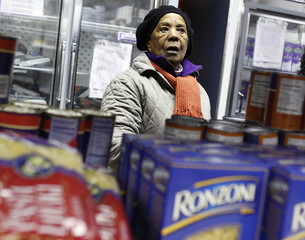 Maria Henningham shops for food items at the Food Bank For New York City Community Kitchen & Food Pantry of West Harlem in New Yo