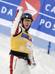 Rochon of Canada celebrates following his jump in the World Cup Freestyle Aerials finals in Calgary
