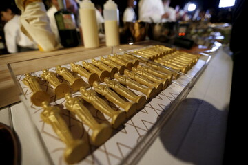 Oscar shaped chocolates are on display during a preview of the food and decor for the 88th Academy Awards' Governors Ball at the Ray Dolby ballroom in Hollywood